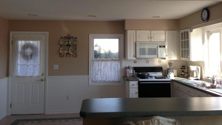 Spacious kitchen recently painted with breakfast bar area