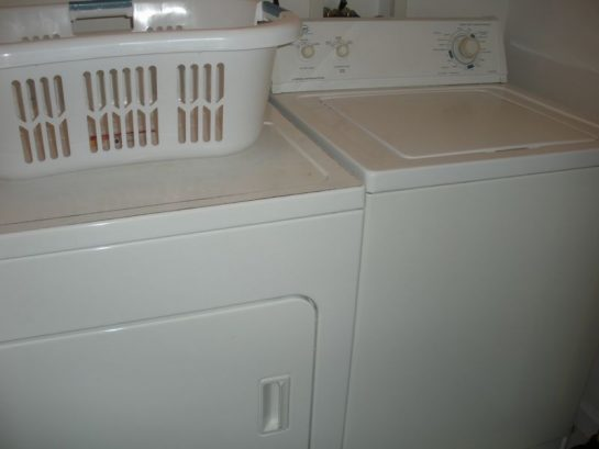 Laundry room LG large top loader washer