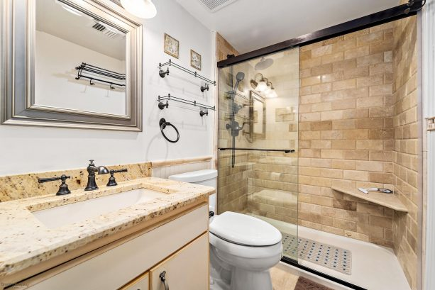Tiled Bathroom w/Moen Polished Brass Fixtures