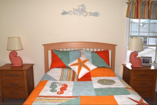 Bright and Cheery Master Bedroom with Queen Bed