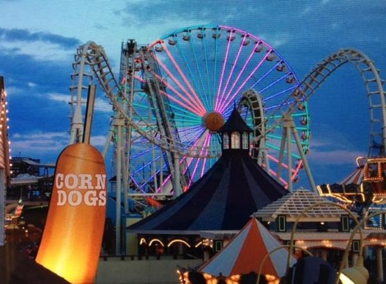 World famous Boardwalk at night. Fantastic Ferris wheel
