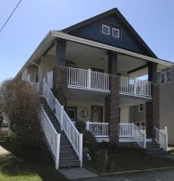 Spacious 3 story home with beach chairs, towels, tags, and parking