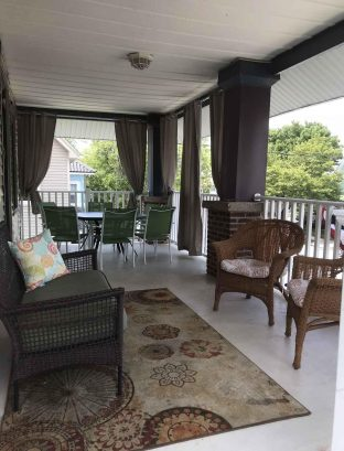2nd floor porch with sun blocking curtains