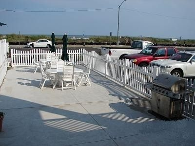 Twin BBQ Grills and Dining Tables on Terrace