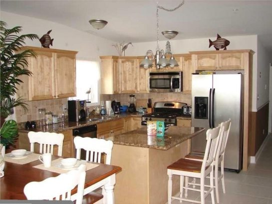 Large well appointed kitchen with seating for 15