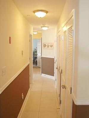 Hallway with laundry closet, main bathroom and bedroom access