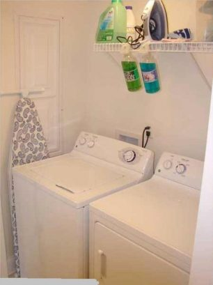 Full size waher and dryer in main hallway laundry closet