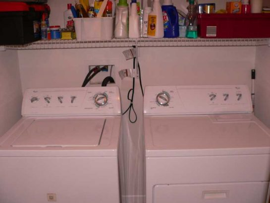Full size washer/dryer, seperate laundry room.