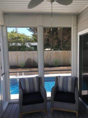 Screen Porch Overlooks Pool
