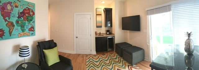Den with wet bar and TV leading to Pool & Porch