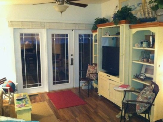 French doors open to screen porch from living room