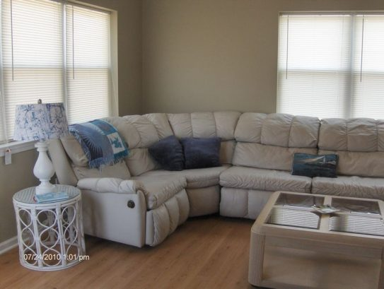 Living Room has Sectional with Queen Pull Out.