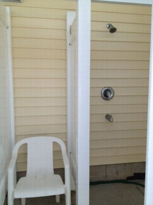 Private outdoor shower with changing area.