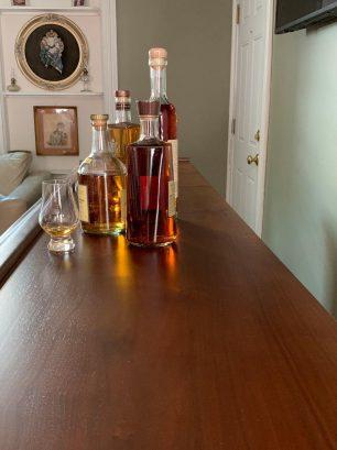 Custom walnut and mahogany bar with 65