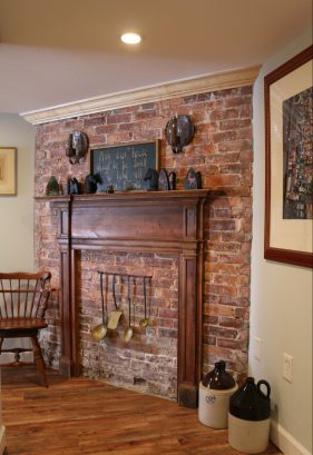 Decorative primitive fireplace in hall