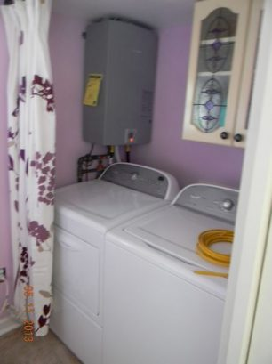 Powder room and laundry room with new washer and dryer