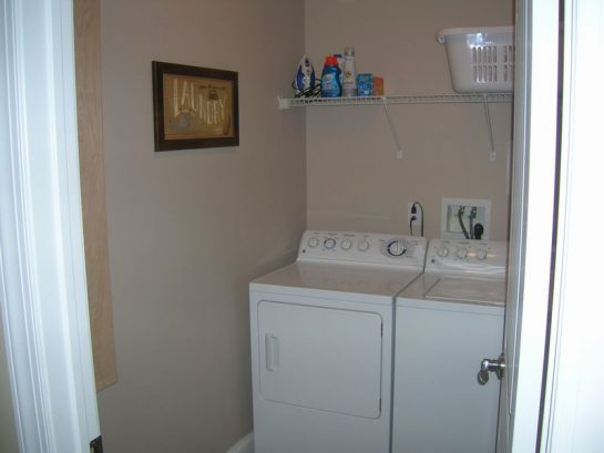 In Condo Laundry Room with Built-in Ironing Board