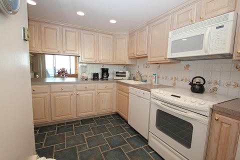 Modern, well stocked kitchen, with plenty of cabinets and counte