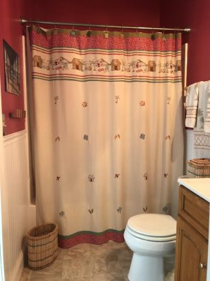Second bathroom with full tub and shower