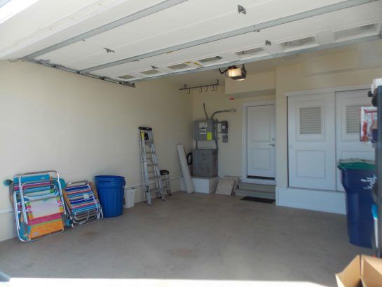Garage with beach chairs and toys