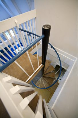 Spiral staircase to second floor bedrooms, baths and decks.