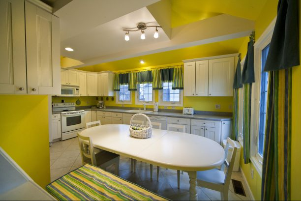 Large, bright eat-in Kitchen with Bar sink and bar stools and table that seats 8-10.