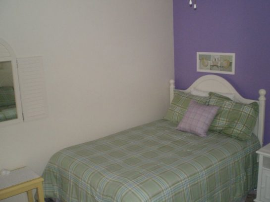 Another view of the purple bedroom. Beautiful