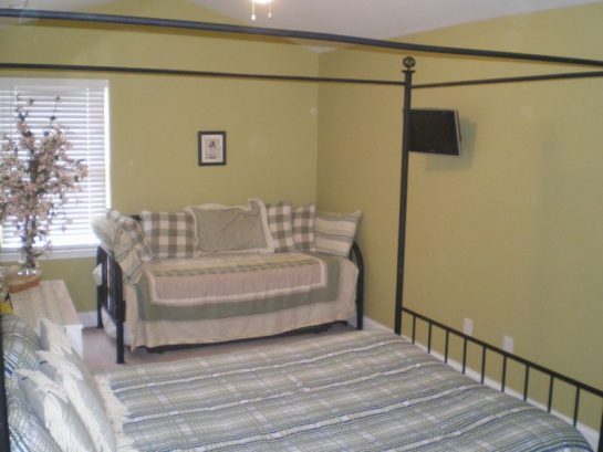Master Bedroom, Queen poster bed plus Day Bed.