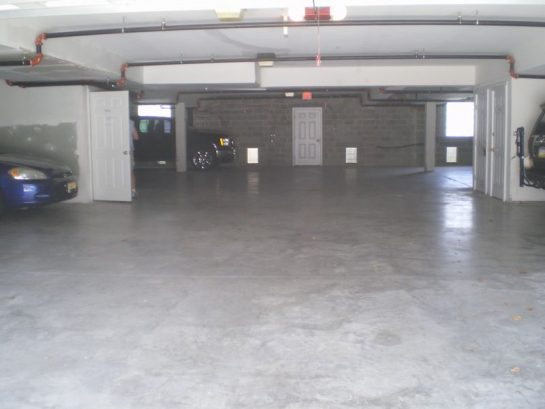Secure inside garage with two reserved parking spaces and storag