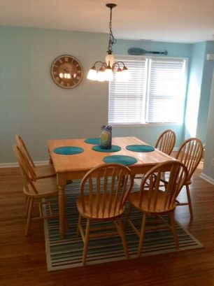 Open kitchen with table to seat 9 plus.