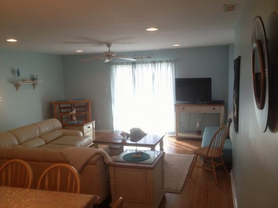 Full sliding doors of living room= large covered deck&furniture.