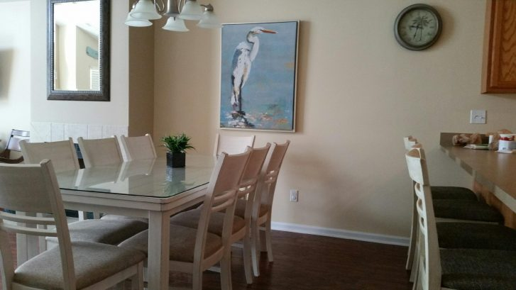 Dining table and view of 4 bar stools