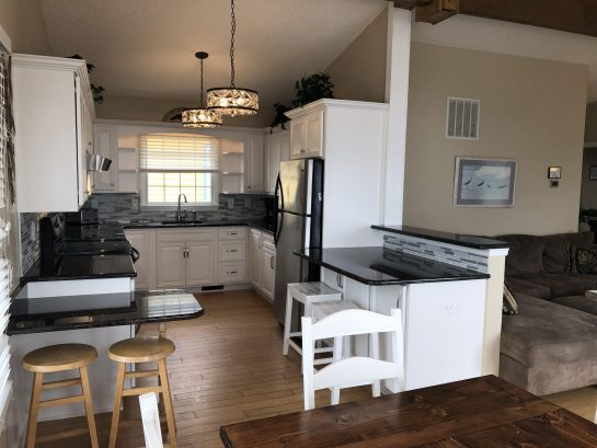 New White Kitchen, open to living room, granite countertops, Island, backsplash, Stainless steel Appliances