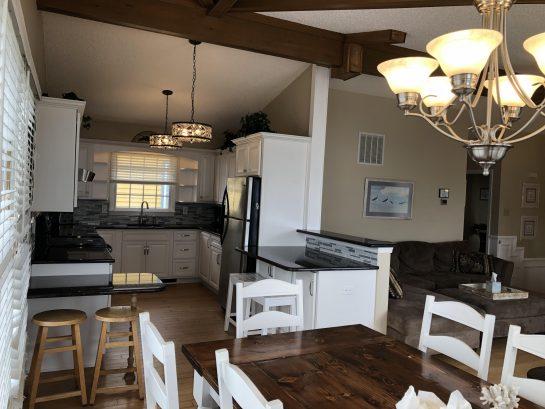 New White Kitchen, granite countertops, Island, backsplash, Stainless steel Appliances