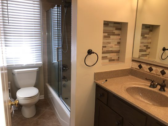updated Hall bath with new tub/shower tile, fixtures, glass door