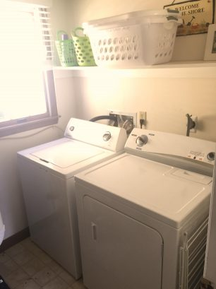 Washer/Dryer, Iron/Ironing board, Drying Rack,  lots of wall hooks for hanging.