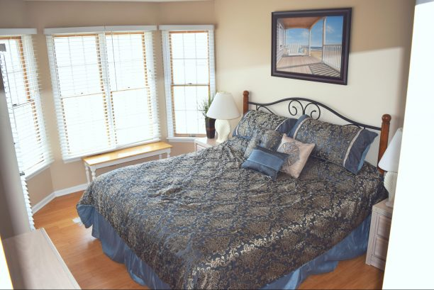 Master bedroom with on-suite, King Size bed, flat screen TV, private deck