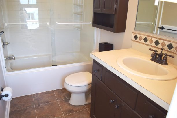 Master Bath with BRAND NEW Bath/shower & BRAND NEW tile floor.