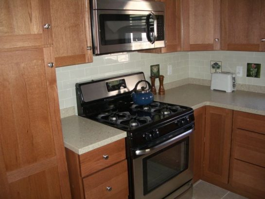 New Kitchen With Oak Cabinets, Solid Core Countertops, Ss Applia