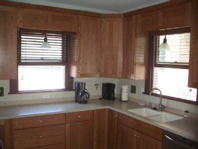 New kitchen with solid core countertops, dishwasher, range with