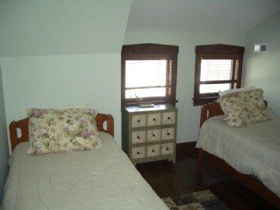 back bay bedroom with twin beds, ceiling fan, 3 windows