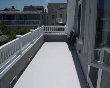 3rd floor rooftop deck with ocean breezes and relaxing furniture
