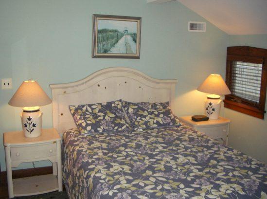 Master bedroom with Queen bed, ceiling fan, door to rooftop deck