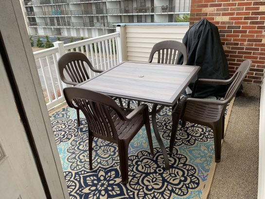 Deck with table seating and electric grill