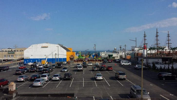 View of ocean and boardwalk from deck