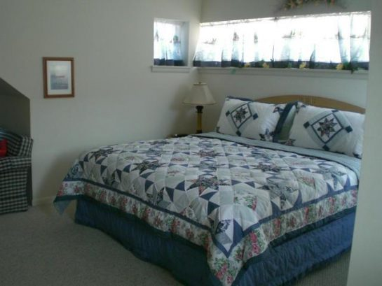 Upstairs king bedroom w sitting area, walk in closet, private bath and tv, ocean view