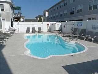 Heated pool area with lounge chairs &