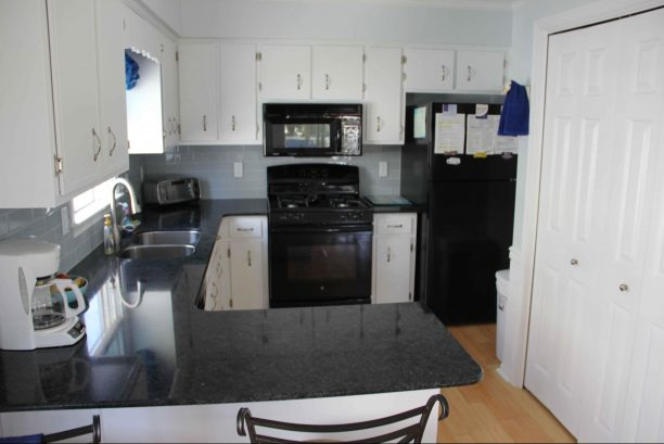 Kitchen with New Appliances and Quartz Countertops