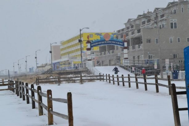 LET IT SNOW at the beach! Sledding the Boardwalk by the North Wildwood Arch!  Always FUN at our North Wildwood Heavenly Havens Oceanfront Vacation Rentals!