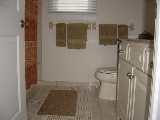 Ceramic Tiled Hall Bath with Shower over Tub 4' Vanity
